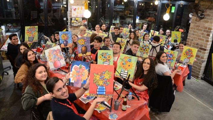 Young people get creative at the Kytherian Youth Association's painting event